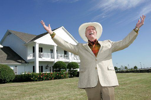 "ORG XMIT: *S0424523461* Actor Larry Hagman poses in front of the  Southfork Ranch mansion made famous in the television show, ""Dallas"",  in Parker, Texas, Thursday Oct. 9, 2008. Hagman was initially reluctant to be on a new TV show called ""Dallas"" when he first read the script in the late 1970s  but is now preparing to celebrate the show's 30th anniversary. (AP Photo/Tony Gutierrez) DN102 03132009xNews 11242012xNEWS"
