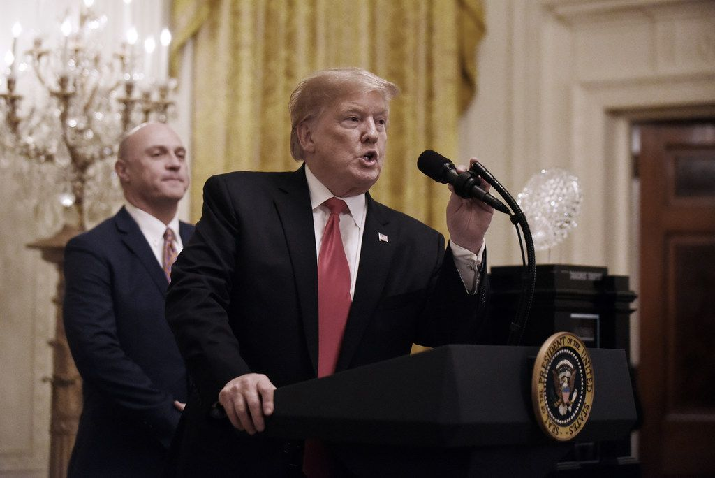 U.S. President Donald Trump speaks as Clemson University President James Clements, left, looks on at an East Room event to host the Clemson Tigers football team at the White House on Jan. 14, 2019 in Washington, DC.  (Olivier Douliery/Abaca Press/TNS)