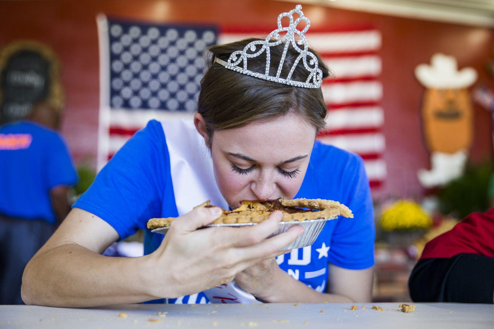 Golden Sweet Potato Queen Macie Pendergrass, 18, participates in a sweet potato pie eating contest during the Golden Sweet Potato Festival Festival on October 27, 2018 in Golden, Texas.