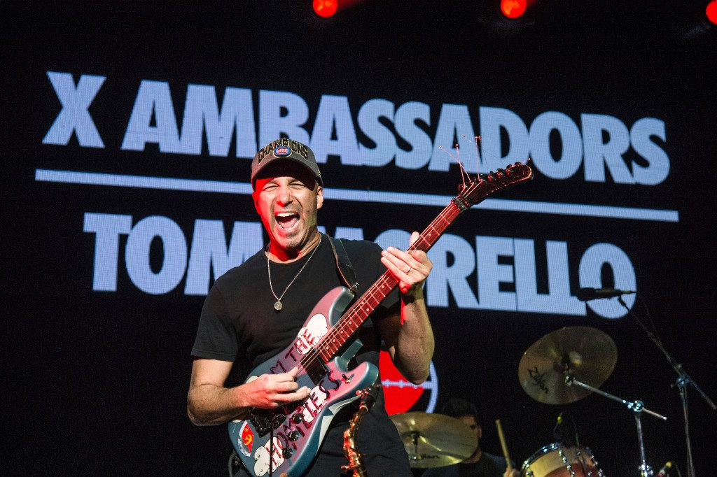 Tom Morello, performs with X Ambassadors at the 2016 KROQ Almost Acoustic Christmas at The Forum on Saturday, Dec. 10, 2016, in Inglewood, Calif. (Photo by Amy Harris/Invision/AP)