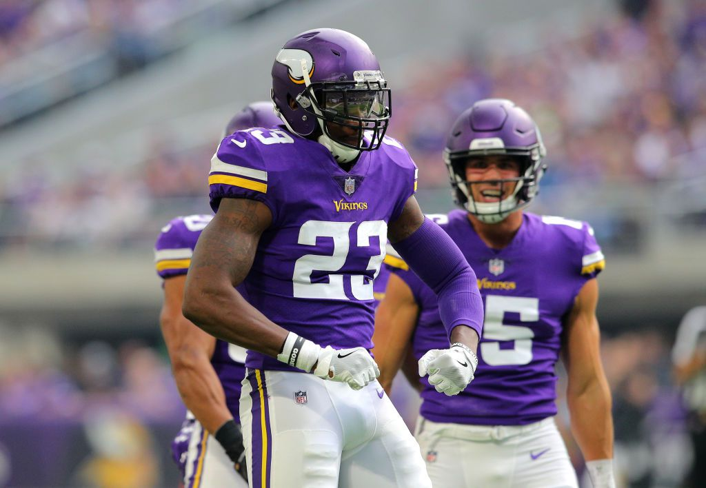 MINNEAPOLIS, MN - OCTOBER 14: George Iloka #23 of the Minnesota Vikings celebrates after making a tackle in the third quarter of the game against the Arizona Cardinals at U.S. Bank Stadium on October 14, 2018 in Minneapolis, Minnesota. (Photo by Adam Bettcher/Getty Images)