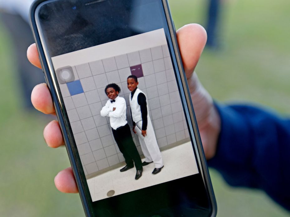 Cameron Jackson shows a photograph of him and Jordan Edwards saved in his cell phone at a vigil at Gentry Elementary School in Mesquite on Monday. Jordan Edwards was shot and killed by a Balch Springs police officer Saturday night.