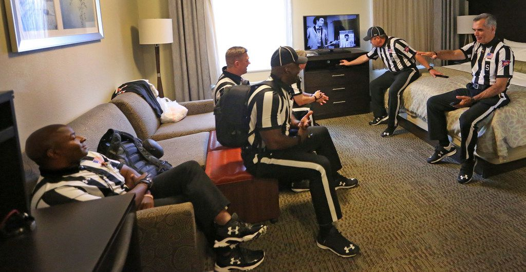 The SEC officiating crew relaxes in a motel room before catching a bus to the stadium before the  Louisiana Lafayette Ragin' Cajuns vs. the Texas A&M Aggies at Kyle Field in College Stadium, Texas on Saturday, September 15, 2017. (Louis DeLuca/The Dallas Morning News)