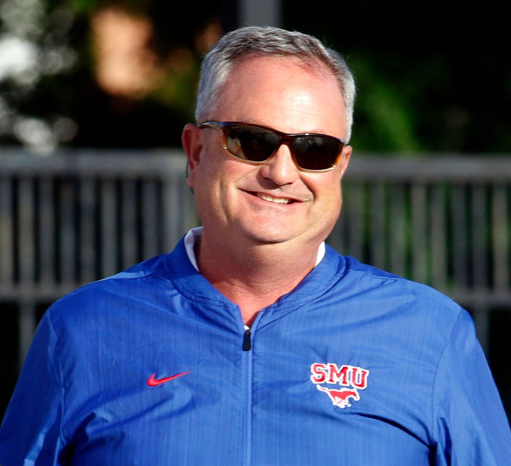 FILE - SMU head coach Sonny Dykes sports a smile at the onset of team drills. The Mustangs football team held an open practice in place of the originally scheduled spring game at SMU's Pettus Practice Fields in Dallas on April 12, 2019