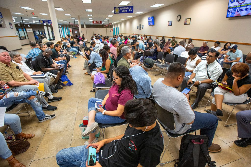 People wait inside a mega center driver license center run by the Texas Department of Public Safety in Garland, Texas, on Wednesday, Sep. 4, 2019.