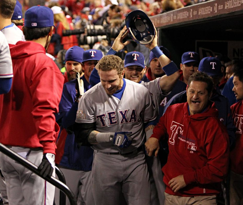 FILE - Teammates clamor around Josh Hamilton (center) after his two-run homer put the Rangers up 9-7 in the 10th inning of World Series Game 6 against the Cardinals at Busch Stadium in St. Louis on Thursday, Oct. 27, 2011. (Louis DeLuca/The Dallas Morning News)