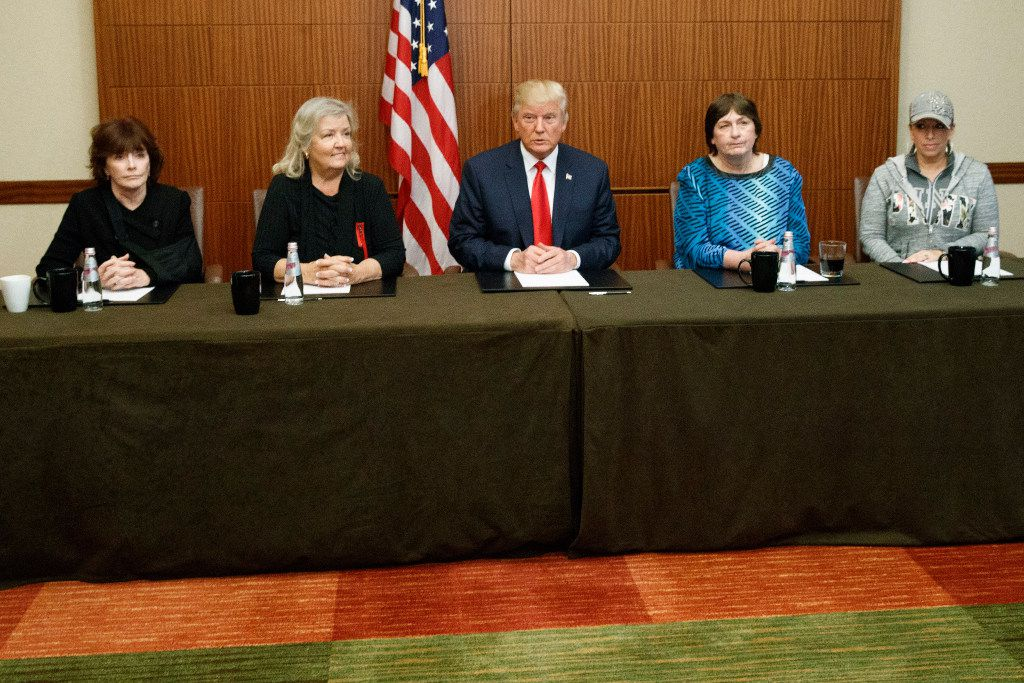 Republican presidential candidate Donald Trump, center, sits with, from right, Paula Jones, Kathy Shelton, Juanita Broaddrick, and Kathleen Willey, before the second presidential debate with democratic presidential candidate Hillary Clinton at Washington University, Sunday in St. Louis.