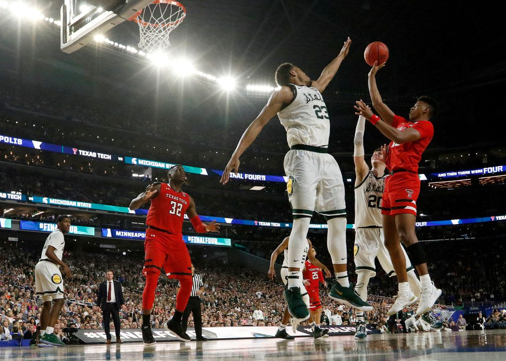 Texas Tech Red Raiders guard Jarrett Culver (23) takes a shot as he is defended by Michigan State Spartans forward Xavier Tillman (23) and Michigan State Spartans guard Matt McQuaid (20) during the second half of play in the semifinals of the Final Four NCAA college basketball tournament at U.S. Bank Stadium in Minneapolis on Saturday, April 6, 2019. Texas Tech Red Raiders defeated the Michigan State Spartans 61-51. (Vernon Bryant/The Dallas Morning News)