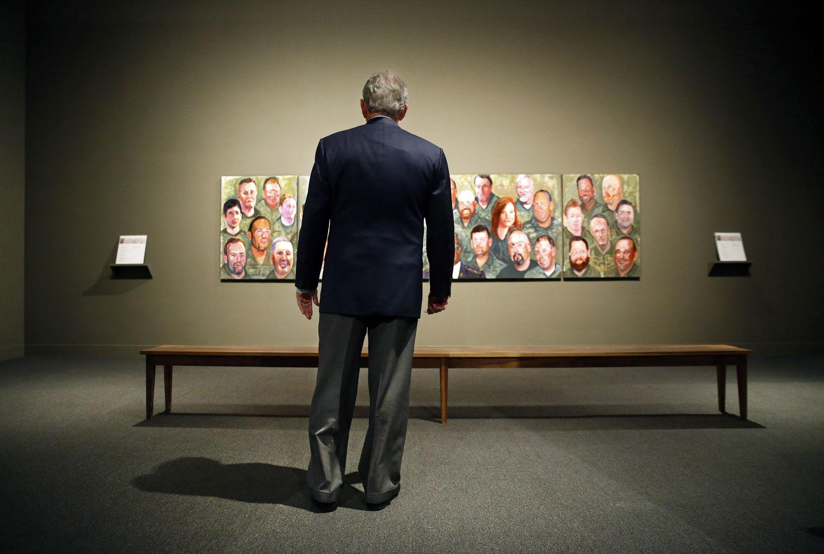 Former President George W. Bush takes a look at the 'Portraits of Courage, A Commander In Chief 's Tribute To America's Warriors' exhibit for the first time since it's been displayed at the George W. Bush Presidential Center in University Park, Texas.(Tom Fox/The Dallas Morning News)