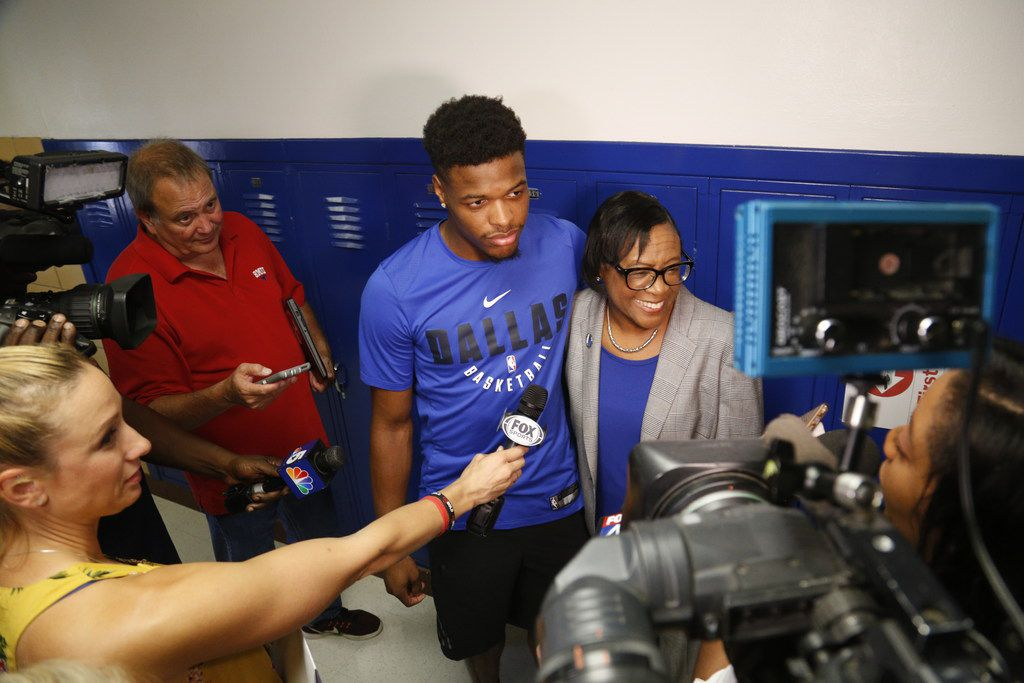 Dallas Mavericks point guard Dennis Smith Jr. with team CEO Cynt Marshall at a DISD back-to-school event this fall where they announced that the Mavs were donating 100,000 activity trackers to the district's elementary schools.