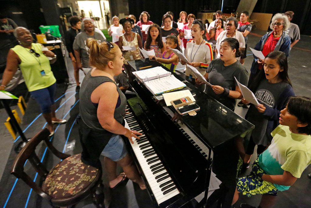 Vonda Bowling, at the keyboard, helps singers rehearse during an Aug. 4 rehearsal for Public Works Dallas, a Dallas Theater Center program where the DTC uses a core company of professional performers and designers to work with 200 members of the community who are not professional actors.