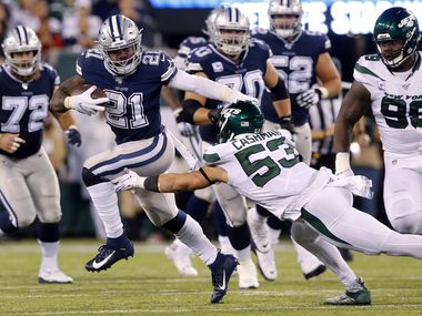 Dallas Cowboys running back Ezekiel Elliott (21) avoids the diving tackle attempt by New York Jets linebacker Blake Cashman (53) at MetLife Stadium in East Rutherford, New Jersey, Sunday, October 13, 2019. (Tom Fox/The Dallas Morning News)
