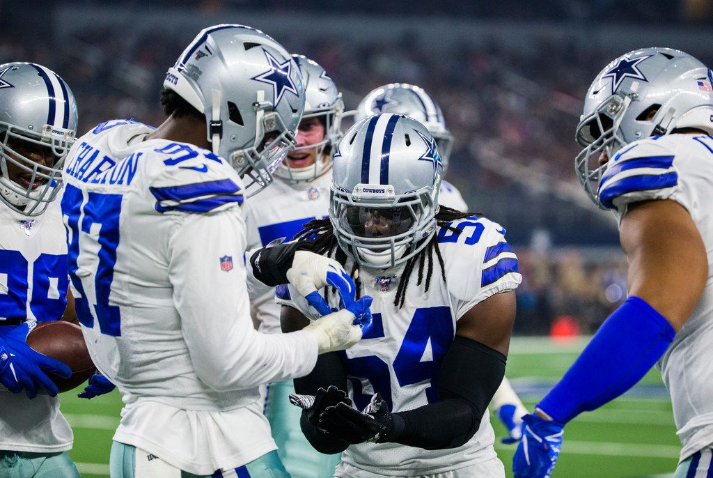 Dallas Cowboys defensive end Taco Charlton (97) celebrates after recovering a fumble after he knocked the ball loose while sacking Houston Texans quarterback Deshaun Watson (4) during the first quarter of an NFL game between the Dallas Cowboys and the Houston Texans on Saturday, August 24, 2019 at AT&T Stadium in Arlington.