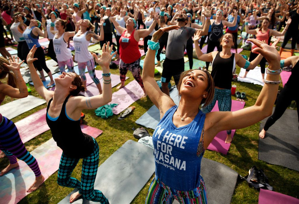 Yoga enthusiasts participate in the Wanderlust group yoga and mediation session following the 5K run on The Lawn at Reunion in downtown Dallas, Saturday, April 15, 2017.