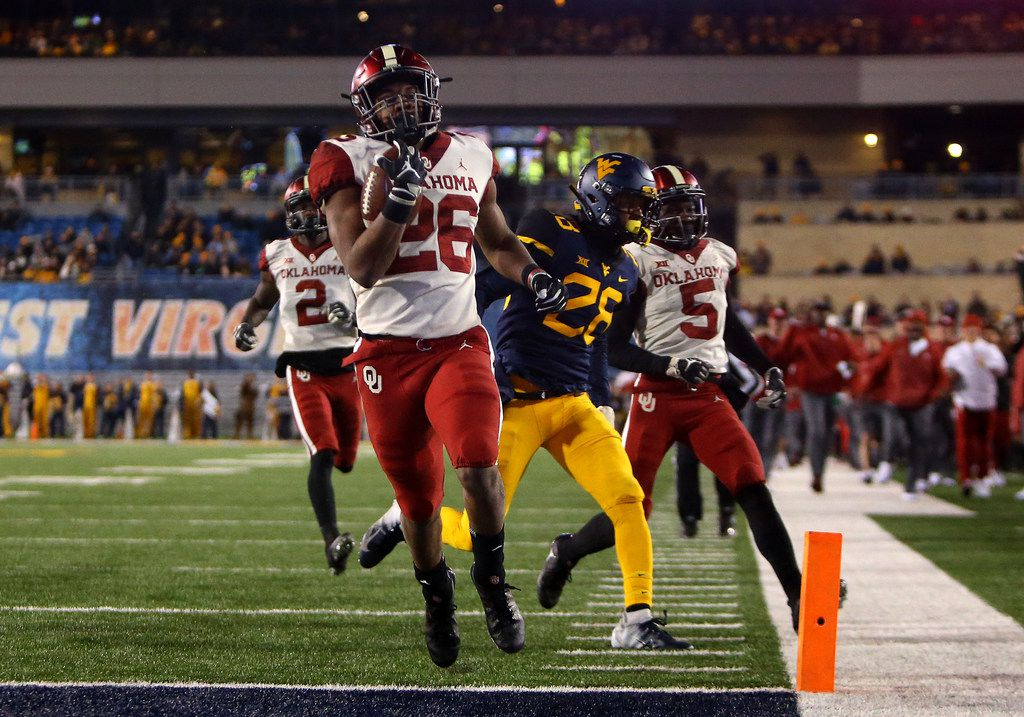 MORGANTOWN, WV - NOVEMBER 23:  Kennedy Brooks #26 of the Oklahoma Sooners rushes for a 68 yard touchdown against the West Virginia Mountaineers on November 23, 2018 at Mountaineer Field in Morgantown, West Virginia.  (Photo by Justin K. Aller/Getty Images)