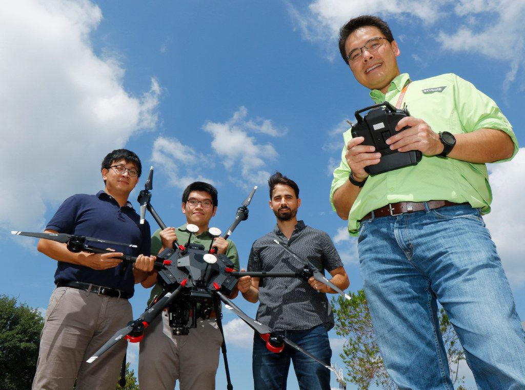 UT-Arlington professor Nick Fang with some of his graduate student and a drone that will be used to collect information on the damage Harvey caused. From left are Daniel Li, Shang Gao and Kevin Wienhold.