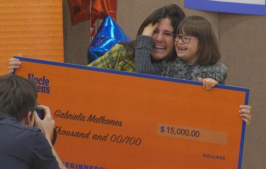 Gabriela Malkomes and her mother, Luciana Malkomes, celebrate winning $15,000 in a contest sponsored by Uncle Ben's.