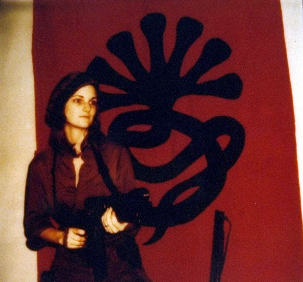 A poster  issued by the Symbionese Liberation Army, shows Patricia  Hearst  as 'Tania' toting a machine gun in front of the revolutionary group's symbol.  In February 1974.