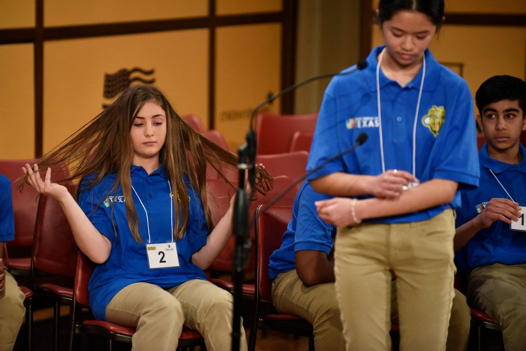 Ruth Davie (left) waits for her turn while Theresa Tran spells a word at Saturday's Golden Chick Dallas Regional Spelling Bee at the George W. Bush Presidential Center in Dallas.