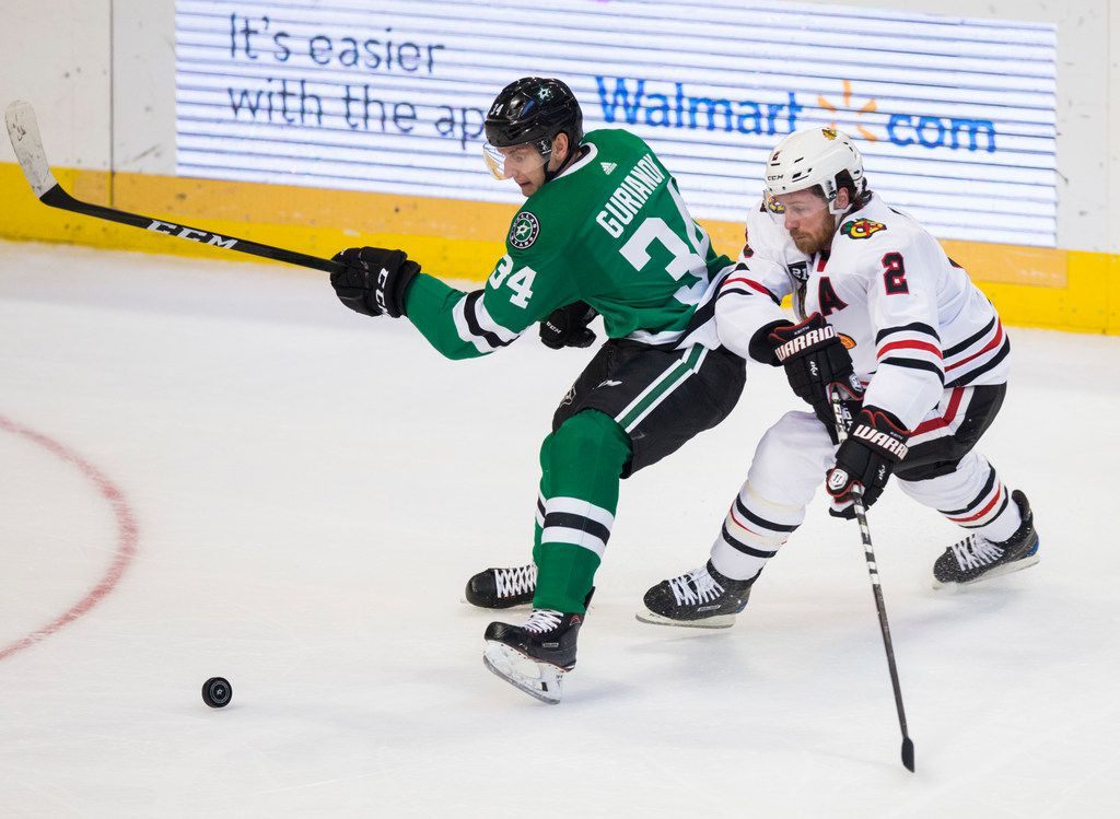 Dallas Stars right wing Denis Gurianov (34) and Chicago Blackhawks defenseman Duncan Keith (2) scramble for the puck during the first period of an NHL game between the Dallas Stars and the Chicago Blackhawks on Thursday, December 20, 2018 at American Airlines Center in Dallas.