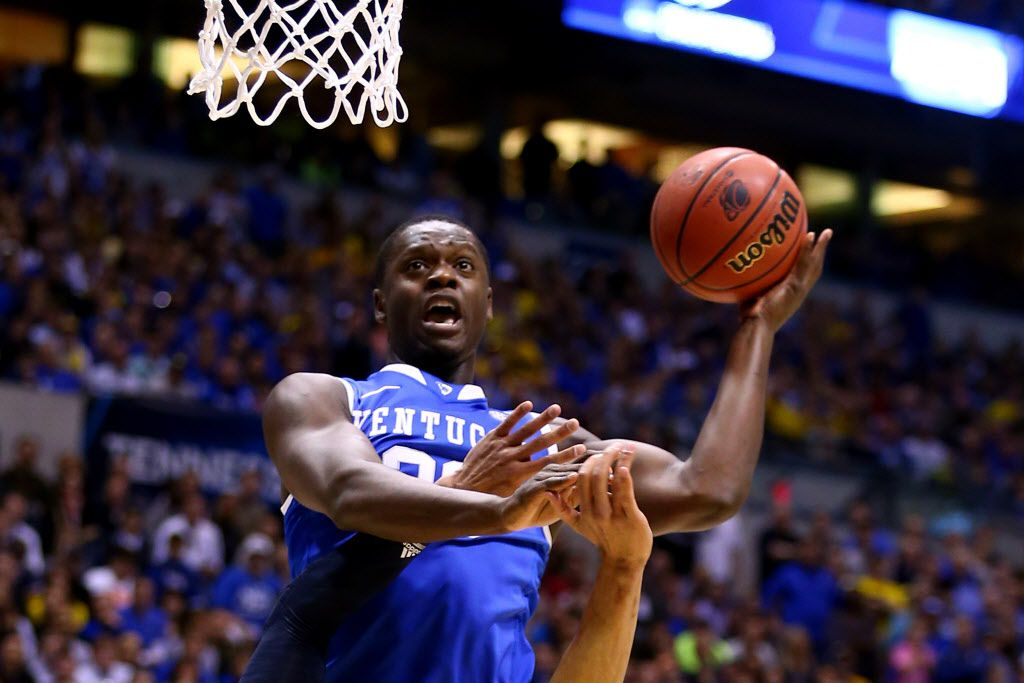 INDIANAPOLIS, IN - MARCH 30:  Julius Randle #30 of the Kentucky Wildcats shoots the ball over Jordan Morgan #52 of the Michigan Wolverines in the first half during the midwest regional final of the 2014 NCAA Men's Basketball Tournament at Lucas Oil Stadium on March 30, 2014 in Indianapolis, Indiana.  (Photo by Andy Lyons/Getty Images)