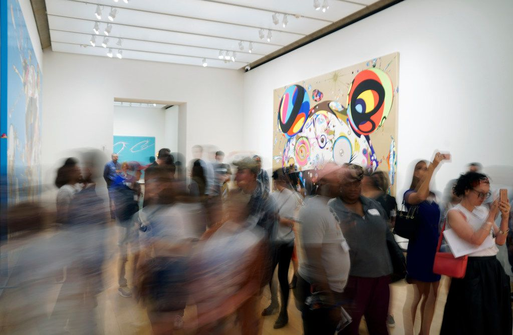 """Dozen's of journalist view Japanese artist Takashi Murakami's exhibit """"The Octopus Eats Its One Leg"""" is on display at the Modern Art Museum in Fort Worth, Texas on Wednesday June 6, 2018."""