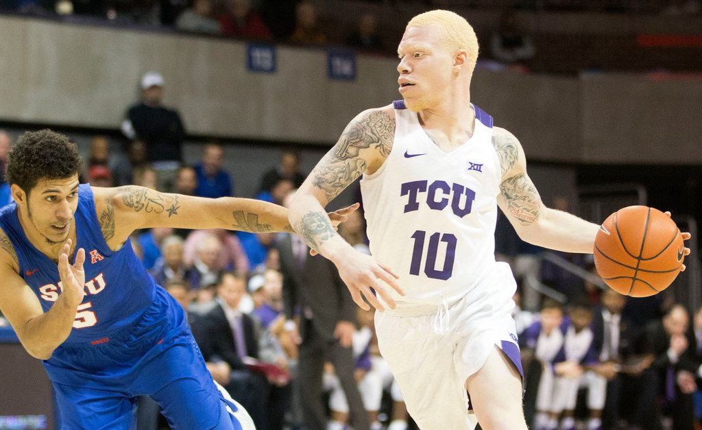 Southern Methodist Mustangs guard Nat Dixon (5) blocks Texas Christian University Horned Frogs guard Jaylen Fisher (10) during a matchup between Southern Methodist University Mustangs and Texas Christian University Horned Frogs at Moody Coliseum in Dallas on Wednesday, December 4, 2018. (Daniel Carde/The Dallas Morning News)