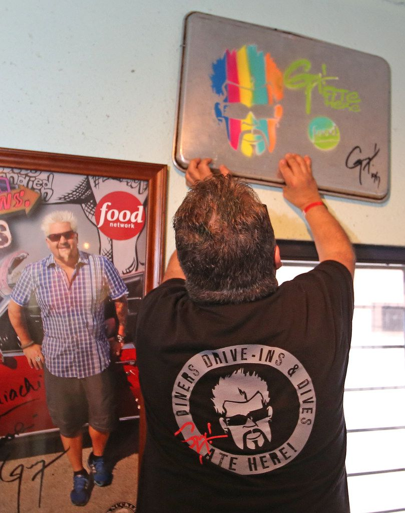 Guy Fieri's likeness is spraypainted on a sheet pan inside Tacos Mariachi, a West Dallas taqueria. This signature piece of artwork proves that Fieri has visited a restaurant for 'Diners, Drive-Ins and Dives.'