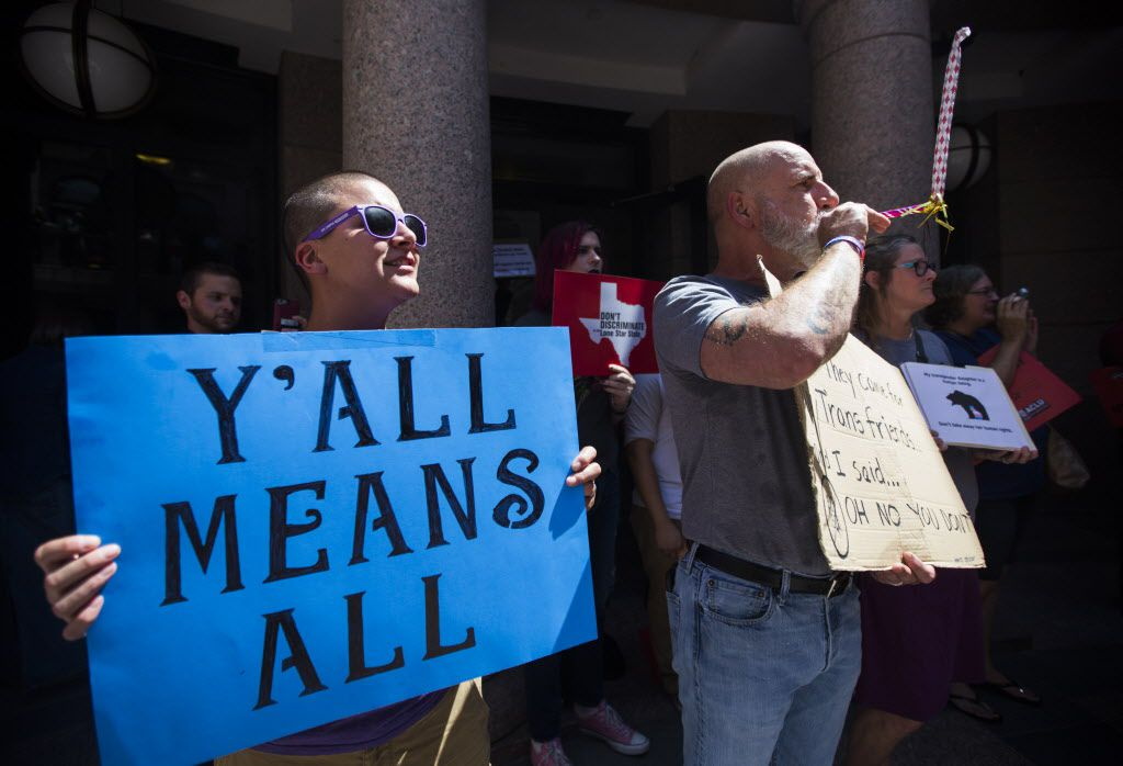 Siobhan Cooke of Nacogdoches and Mark Jiminez of Dallas were among protesters rallying against the bathroom bill on the fourth day of a special legislative session in July 2017 at the state Capitol in Austin.