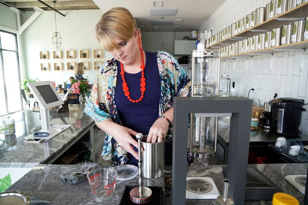 Tiffany Malkowski prepares a cup of tea at Leaves Book and Tea Shop in Fort Worth.