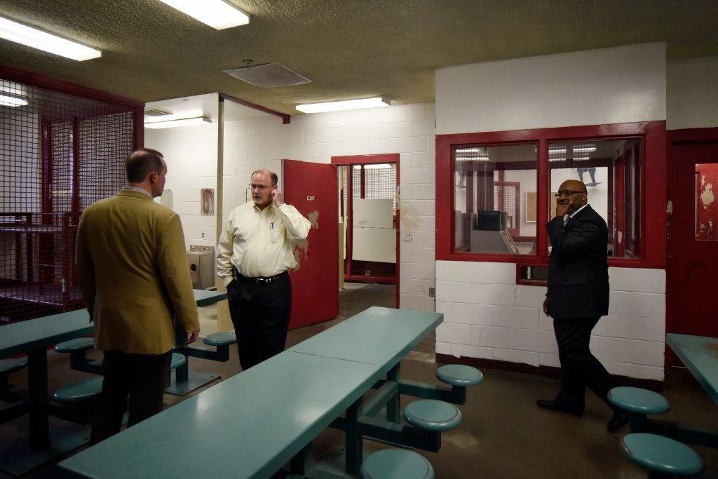 From left: Dallas City Council member Philip Kingston; David Sweetin, deputy director for the Texas Department of Criminal Justice' Facilities Division; and Dallas City Manager T.C. Broadnax tour a dining and sleeping area inside the old Dawson State Jail. (Ben Torres/Special Contributor)