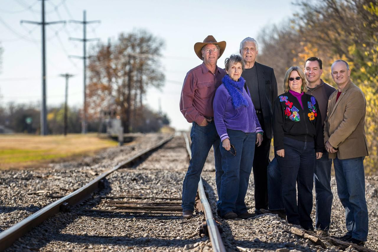 Rockwall County Open Space Alliance members (from left) Bob DeJean, Nell Welborn, Dale Morgan and Becky Burkett, Verdunity principal Kevin Shepherd and Fate Mayor Lorne Megyesi visit a proposed rail corridor trail.