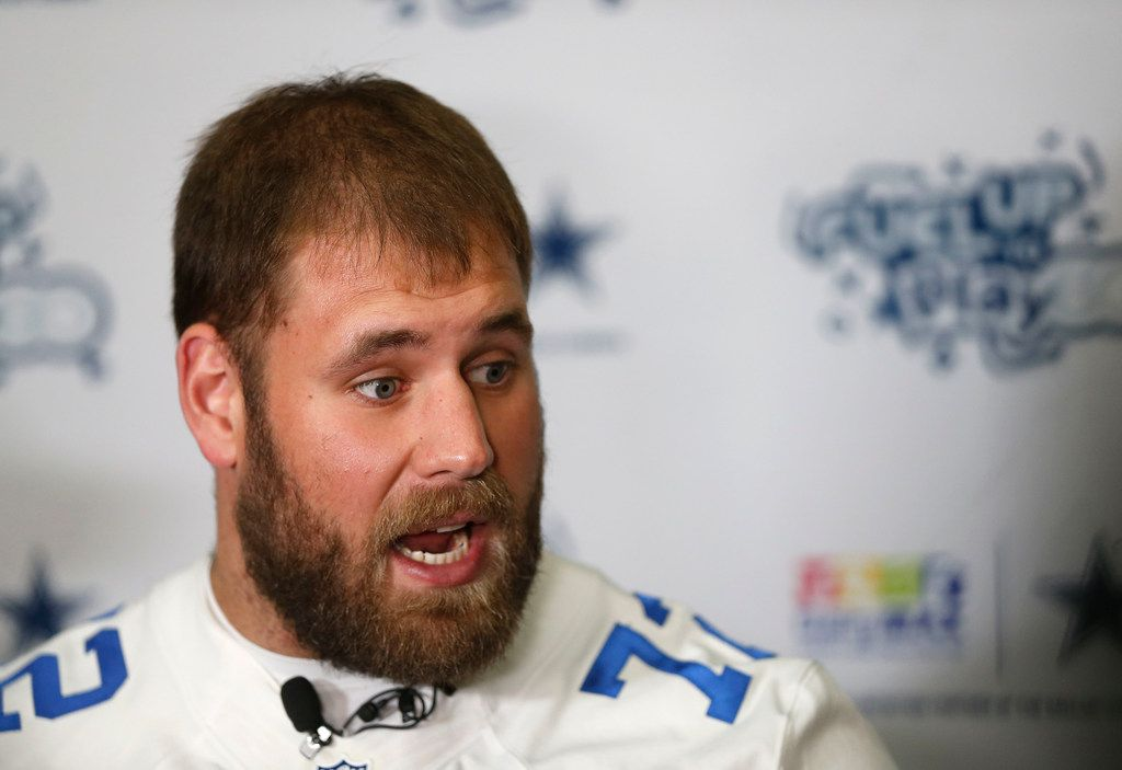 Cowboys center Travis Frederick talks with the media at Hillcrest High School in Dallas, Thursday, Feb. 15, 2018. (Jae S. Lee/The Dallas Morning News)