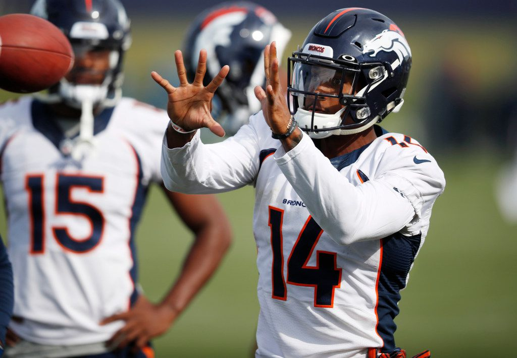 Denver Broncos wide receiver Courtland Sutton catches a pass during an NFL football training camp practice at the team's headquarters Tuesday, Ju;ly 30, 2019, in Englewood, Colo. (AP Photo/David Zalubowski)