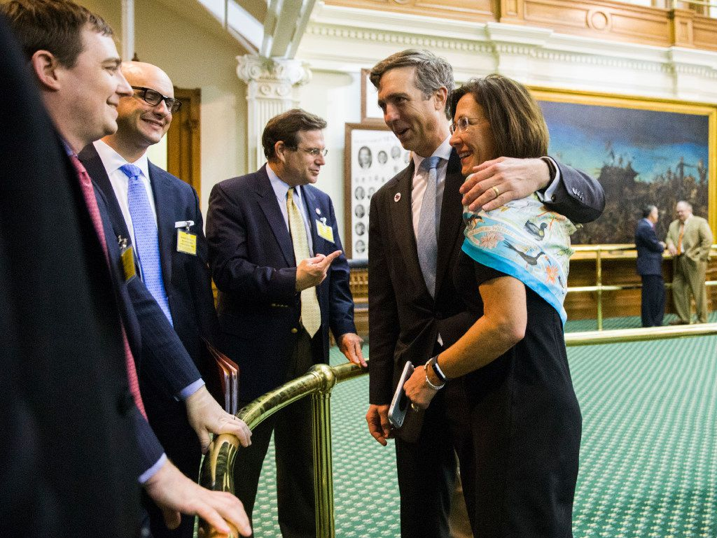 Sen. Van Taylor (center), author of the sunset bill, is congratulated by Sen. Lois Kolkhorst, Gov. Greg Abbott's Chief of Staff Daniel Hodge (left)  and others after the bill was passed during a midnight session of a special legislative session on Thursday at the Texas Capitol in Austin.