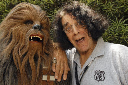 Actor Peter Mayhew,who played Chewbacca in Star Wars movies, posed with a Chewbacca character  during Star Wars Weekends at Walt Disney World Resort in Lake Buena Vista, Fla. Mayhew lived in Boyd, Texas, near Dallas-Fort Worth.