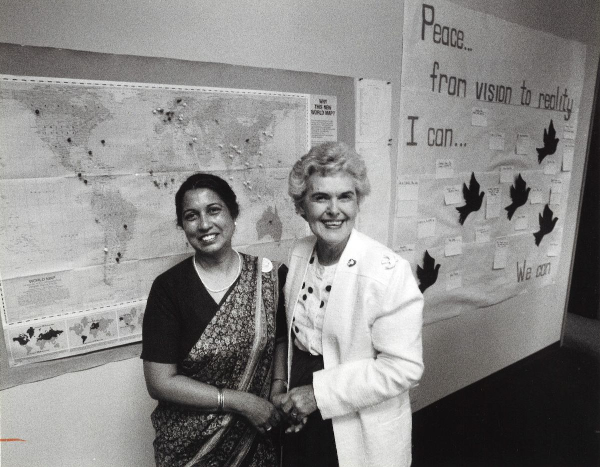 Vivian Castleberry greeted Maya Michael of India, a delegate at the Women's Peace Conference in Dallas.