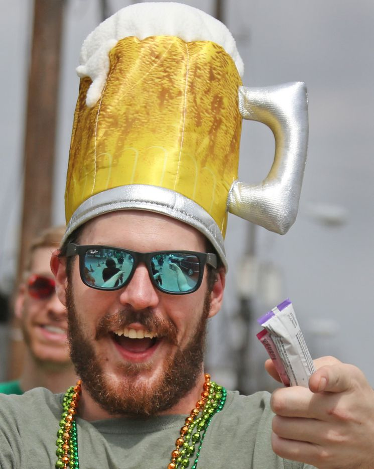 Brett Buchanan got in the spirits of things at the block party during the Dallas St. Patrick's Parade & Festival along Greenville Avenue in Dallas on Saturday.