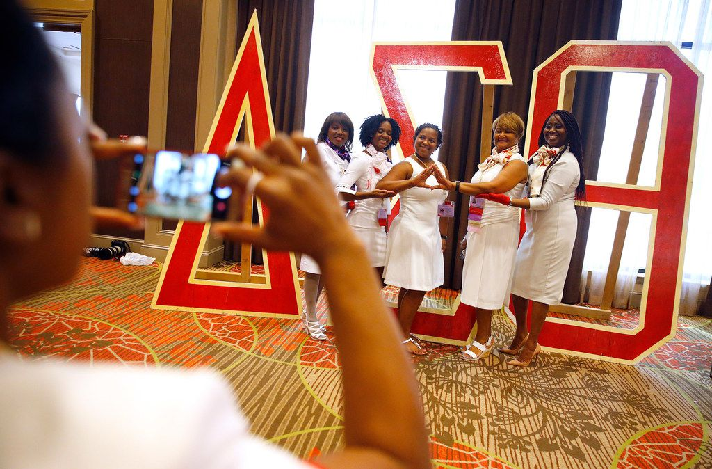 A group of Delta Sigma Theta Sorority members pose with the greek letters at their regional conference held at the Sheraton Dallas Hotel, Friday, July 20, 2018.
