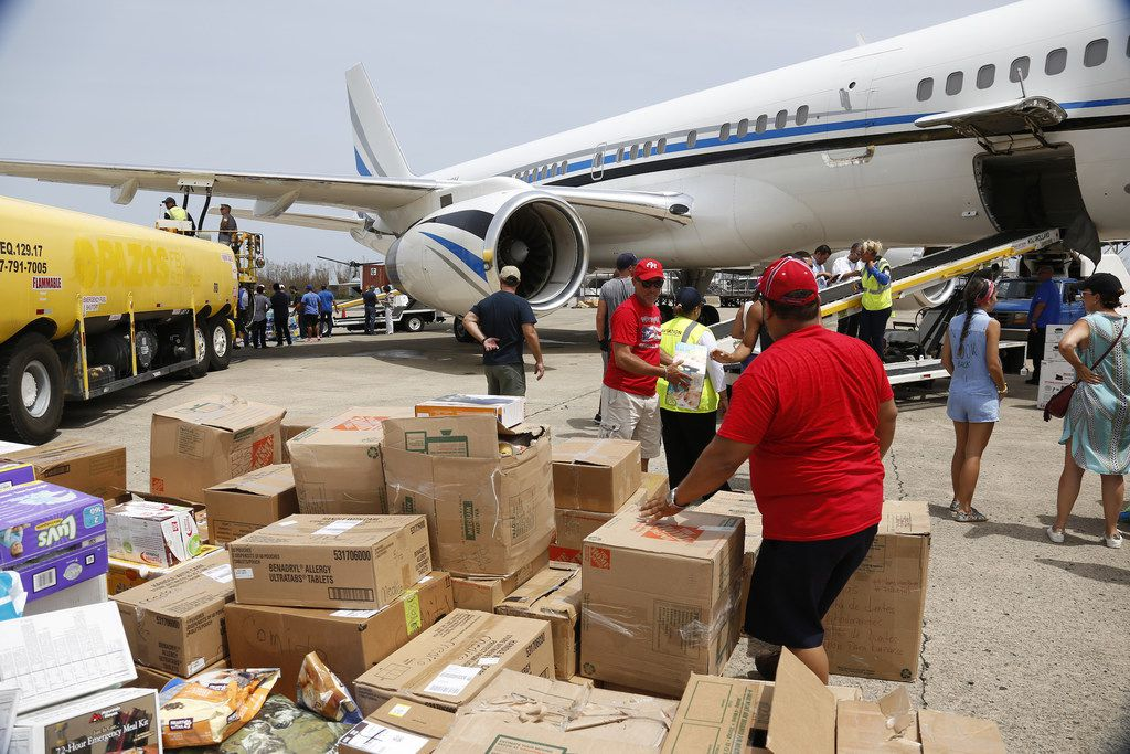 Hurricane relief supplies are unloaded from the Dallas Mavericks plane in San Juan, Puerto Rico where Mavericks guard J. J. Barea's foundation was at work Sept. 25, 2017. Barea and his wife flew to the his homeland after Mavericks owner Mark Cuban made the plane available.