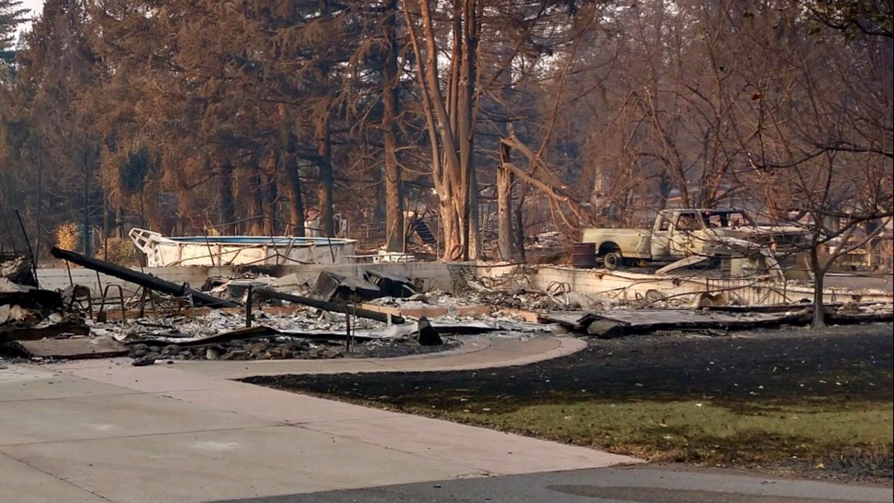 Dale Morgan's house in Paradise, Calif., after it was destroyed in the deadly Camp Fire. A neighbor took the photo of Morgan's home. Despite being a California native, Morgan is a Dallas Cowboys fan and still plans to see the team play at AT&T Stadium on Thanksgiving Day.