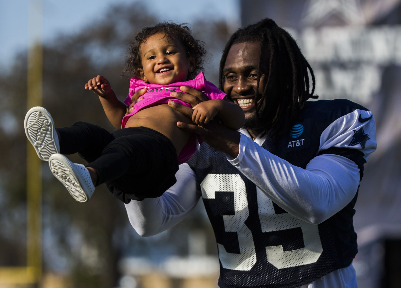 Dallas Cowboys free safety Kavon Frazier (35) plays with his daughter, Kali Frazier, 15 months, after an afternoon practice at training camp in Oxnard, Calif., on July 29, 2019.