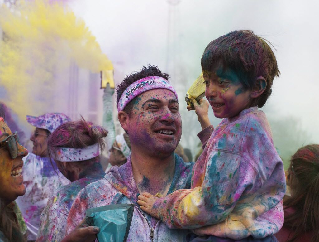 How will you color your world this year? At the color Run in Fair Park a few years ago, Hector Ochoa holds his nephew Leo Cruz. in this file photo.