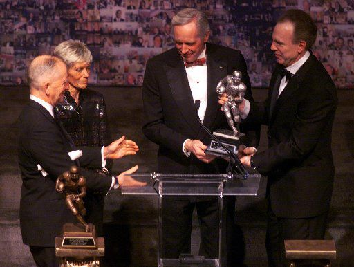 From left: Ross Perot, Skeeter Walker, Pete Dawkins and Roger Staubach pose with the  Doak Walker Legends Award  that was presented to Dawkins at the Fairmont Hotel in Dallas in 2000.
