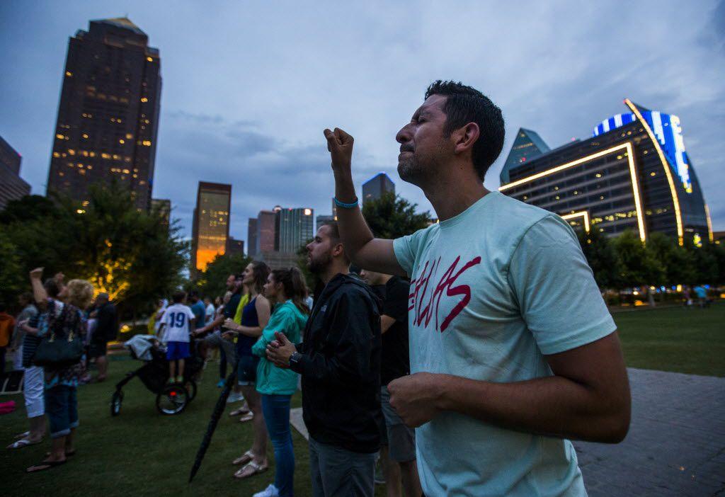 Brandon Sanchez sings Saturday at a service in downtown Dallas. (Ashley Landis/Staff Photographer)