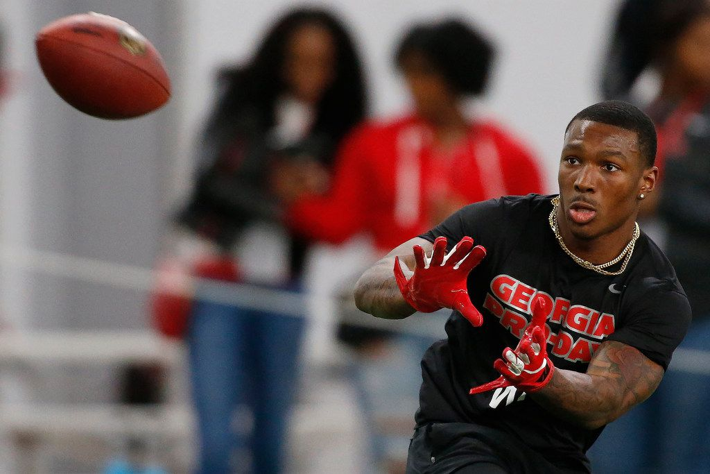 Georgia wide receiver Mecole Hardman (4) reaches for a pass during Pro Day at the University of Georgia, Wednesday, March 20, 2019, in Athens, Ga. (Joshua L. Jones/Athens Banner-Herald via AP)