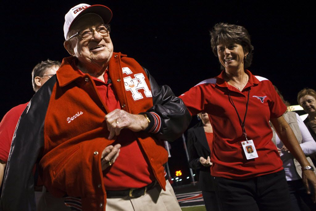 Raymond Dennis, 88, is honored with a letterman's jacket presented to him by administrator Gina Farmer and his family during the Cedar Hill School Homecoming football game on September 30, 2011. (Patrick T. Fallon/The Dallas Morning News)