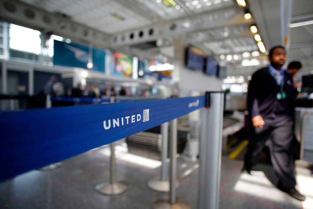 """(FILES) This file photo taken on April 12, 2017 shows an airport worker walking through the United Airlines terminal at O'Hare International Airport in Chicago, Illinois.  United's widely-condemned violent removal of a passenger from a flight was a """"system failure"""" and no employees will lose their jobs as a result, United Continental chief Oscar Munoz said April 18, 2017.""""It was a system failure across various areas, so there was never a consideration for firing an employee or anyone around it,"""" Munoz said on a conference call.  / AFP PHOTO / Joshua LOTTJOSHUA LOTT/AFP/Getty Images"""