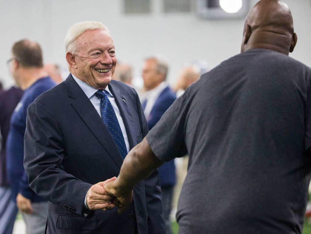 Cowboys owner Jerry Jones greets former player Charles Haley during a training camp practice at The Star in Frisco on Thursday, Aug. 23, 2018. (Ashley Landis/The Dallas Morning News)