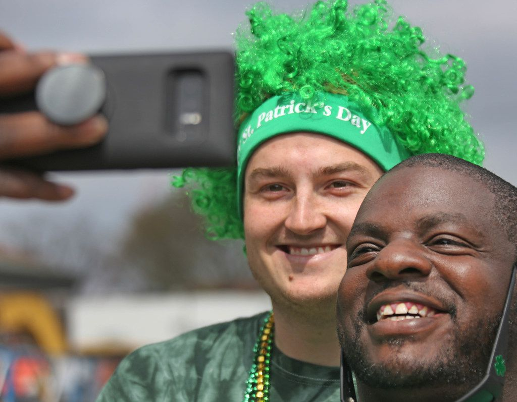 There were plenty of opportunities for selfies with friends at the block party during the Dallas St. Patrick's Parade & Festival along Greenville Avenue in Dallas on Saturday.
